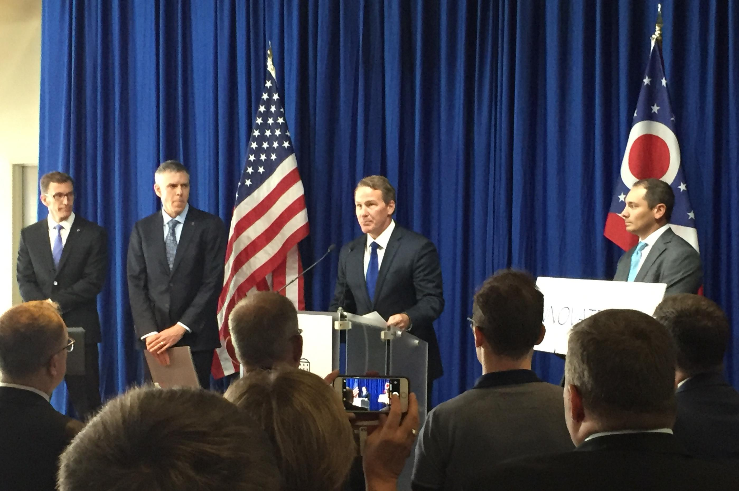 Lt. Gov. Jon Husted is flanked by Ohio's State's associate vice president of technology commercialization Kevin Taylor and others as he announces the Ohio IP Promise.